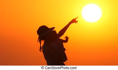 Graceful mother with child. Baby on mothers hands on sunset ...