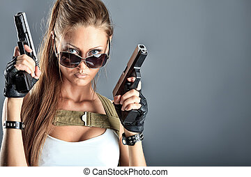 graceful - Shot of a sexy military woman posing with guns.