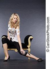graceful woman sitting on stool