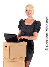 Graceful young businesswoman typing on laptop. Studio shot. White background