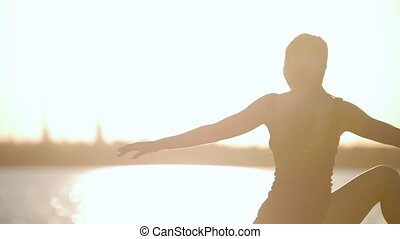 Graceful Young Woman Trains Before The Running At Sunset By...
