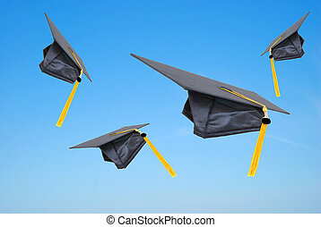 Grad Caps - graduation caps thrown in the air