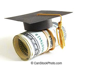 grad money - mini graduation cap on a roll of money