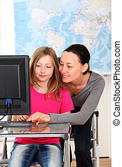 Grade-school girl in class with teacher