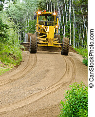Grader resurfacing narrow rural road - Large yellow grader ...