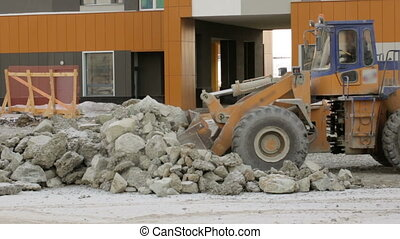 Grader working at building site
