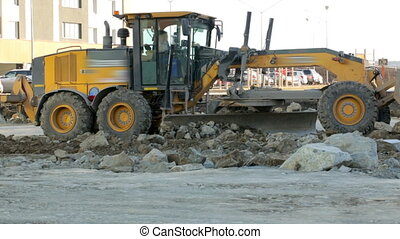 Grader working at construction site