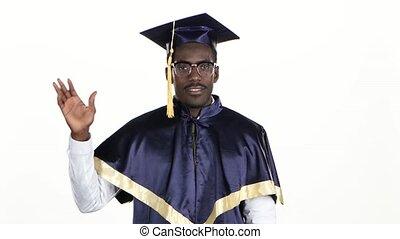 Graduate affably waving hello. White. Close up - Graduate...