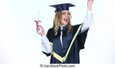 Graduate celebrating college graduation. White. Slow motion