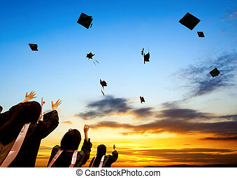 Graduate - Chinese graduates and sunset sky.