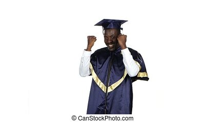 Graduate dancing. White - Man in the garb of a graduate is...