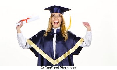 Graduate dancing with diploma in the hands. White
