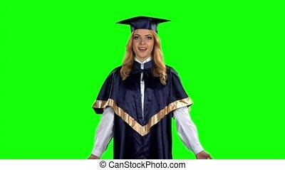 Graduate girl. Surprise. Green screen. Slow motion