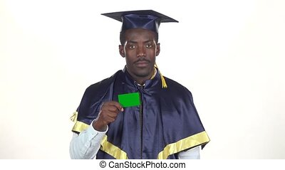 Graduate holding a green card. White. Slow motion. Close up
