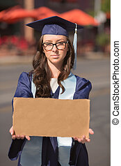 Graduate Holding Blank Sign