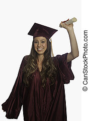 graduate in cap and gown with diploma