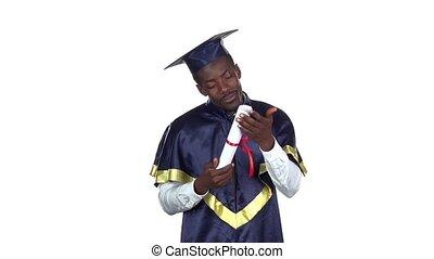 Graduate kissing diploma. Slow motion. White - Student...