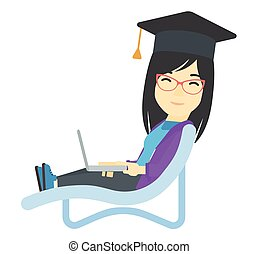Graduate lying in chaise lounge with laptop.