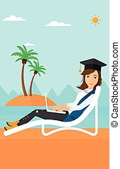 Graduate lying on chaise lounge with laptop.