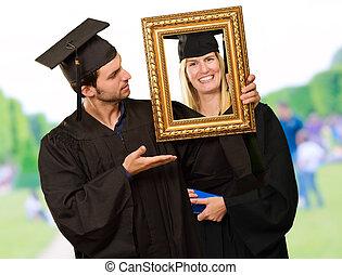 Graduate Man Holding Frame