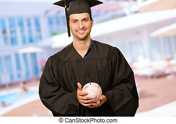 Graduate Man Holding Piggybank