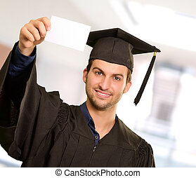 Graduate Man Showing Placard