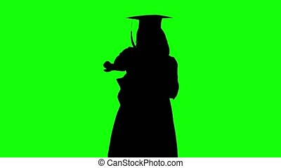 Graduate of dancing in front of the camera.. Silhouette. Green screen