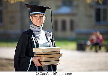Graduate of university with books