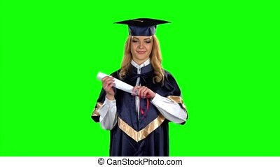 Graduate opens his diploma. Green screen. Slow motion