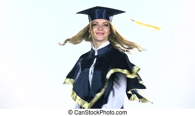 Graduate sends an air kiss. White. Slow motion