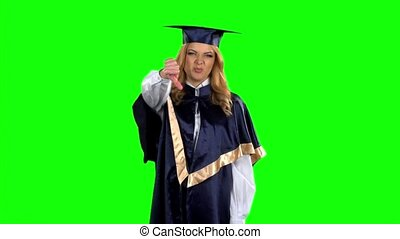 Graduate showing thumbs down. Green screen. Slow motion