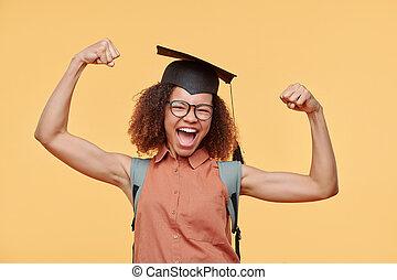 Graduate student flexing muscles