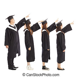 graduate students standing a row and pointing the same