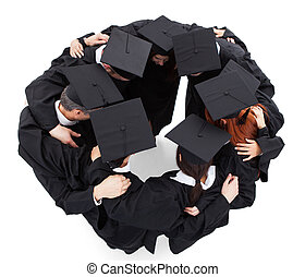 Graduate students standing in circle