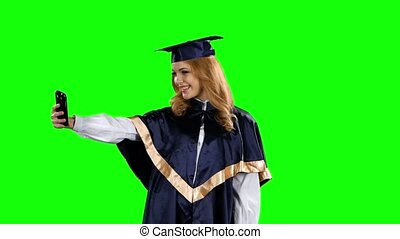 Graduate take self portrait. Green screen