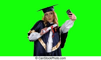Graduate take selfe photo with diploma. Green screen