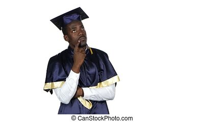 Graduate thinks and smiling. White. Close up