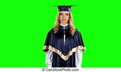 Graduate threatening finger and shows sign quietly. Green screen