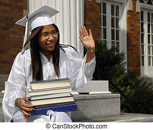 Graduate Wave - Studious graduate on her school steps with a...