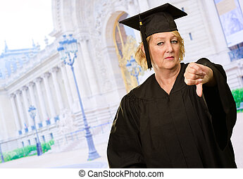 Graduate Woman Showing Thumb Up Down