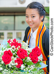 Graduated girl with red rose