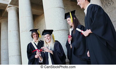 Graduated students taking themselves in picture