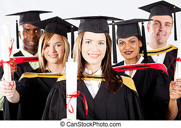 graduates in graduation gown and cap - group of graduates in...