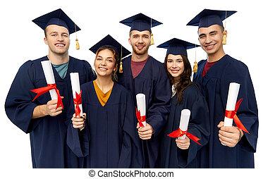 graduates in mortar boards with diplomas