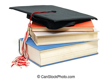 Graduating School - An isolated shot of a Grad hat and books...