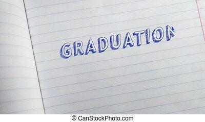 Text GRADUATION 2021 handwritten on sheet of notebook.