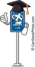 Graduation airport sign stuck to cartoon wall