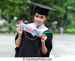 Graduation asian girls with congratulation in Thai wording