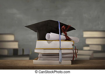 Graduation cap above stack books with degree paper