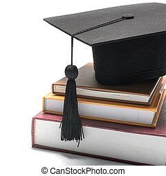 graduation cap and book